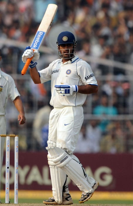 Mahendra Singh Dhoni raises his bat after scoring a century on the third day of the second Test match between India and South Africa at The Eden Gardens Cricket Stadium in Kolkata on February 16, 2010. India have scored 643 runs for the loss of six wickets after the South African score of 296 runs in their first innings. (AFP Photo)