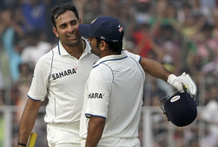 Mahendra Singh Dhoni (right) congratulate teammate VVS Laxman for scoring a century during the third day of the second Test match against South Africa in Kolkata on Tuesday. (AP Photo)
