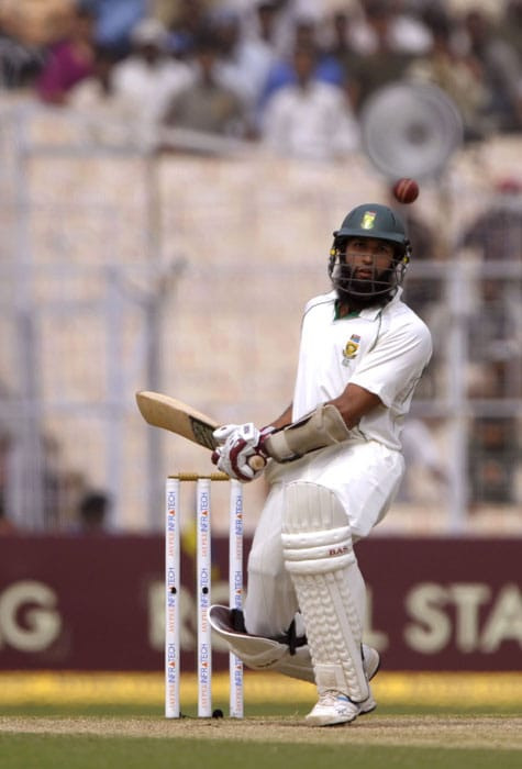 Hashim Amla plays a shot during the fourth day of the second Test match between India and South Africa at The Eden Gardens Stadium in Kolkata on February. The second-ranked South Africa will take over from India if the match ends in a draw, giving the Proteas a 1-0 series win. (AFP Photo)