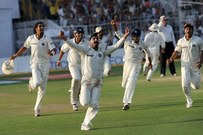 Harbhajan Singh (3R) and teammates celebrate the last wicket of South African cricketer Morne Morkel as India win the match and level the series during the final day of the second Test match between India and South Africa at The Eden Gardens Stadium in Kolkata. India defeated South Africa by an innings and 57 runs in the second and final Test to draw the series 1-1. India, who lost the first Test in Nagpur by an innings and six runs, retained their number one spot in the official Test rankings. (AFP Photo)