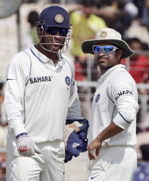 Mahendra Singh Dhoni and Sachin Tendulkar look on during the fifth day of the second Test between India and South Africa in Kolkata. (AP Photo)