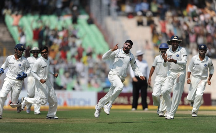 Harbhajan Singh celebrates the dismissal of Jean-Paul Duminy during the final day of the second Test match between India and South Africa at the Eden Gardens Stadium in Kolkata. (AFP Photo)