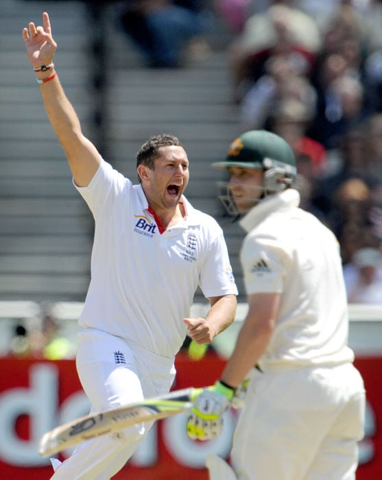 England bowler Tim Bresnan celebrates dismissing Australian batsman Phil Hughes on the first day of the fourth Ashes Test match in Melbourne. (AFP Photo)