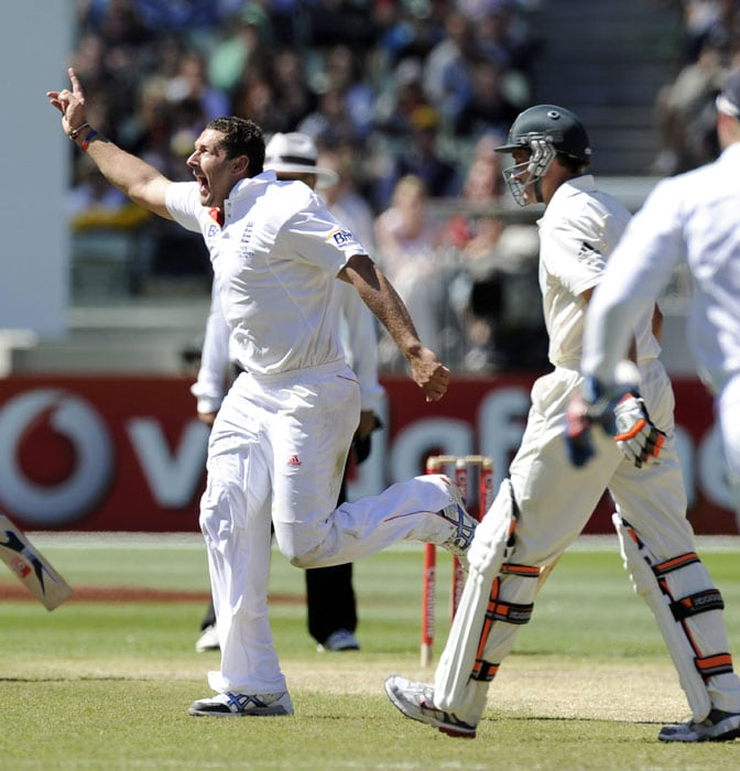 England's Tim Bresnan celebrates after capturing the wicket of Australia's Mike Hussey, during the third day of the fourth Ashes cricket test at the MCG in Melbourne. (AP Photo)