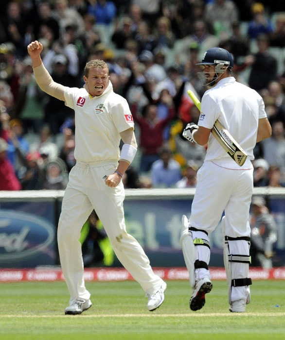 Australia's Peter Siddle, celebrates after getting out England's Kevin Pietersen, LBW during the second day of the fourth Ashes cricket test match at the Melbourne Cricket Ground. (AP Photo)