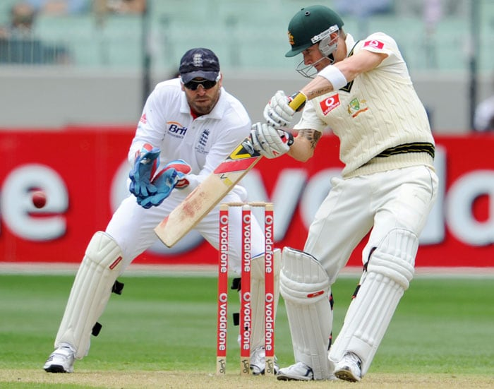 Australian batsman Michael Clarke cuts a ball away as England wicketkeeper Matt Prior looks on during the first day of the fourth Ashes Test match in Melbourne. (AFP Photo)