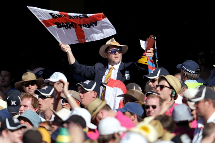 English supporters cheers on their team on the third day of the fourth Ashes cricket Test match, in Melbourne. (AFP Photo)