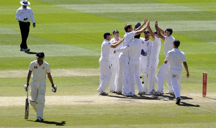 England players celebrate the wicket of Australia's Mitchell Johnson during the fourth Ashes Test against Australia at the MCG in Melbourne. (AP Photo)