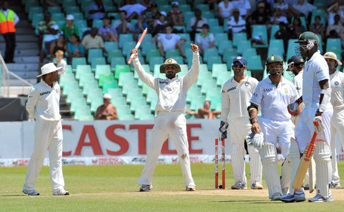 Harbhajan Singh celebrates his team's victory on the fourth day of the second Test between India and South Africa at the Kingsmead Stadium in Durban. (AFP Photo)