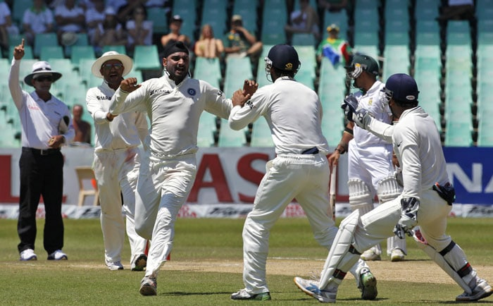 Harbhajan Singh celebrates with teammates as umpire Asad Rauf signals the dismissal of AB de Villiers for 33 runs on the fourth day of the second Test between India and South Africa at the Kingsmead stadium in Durban. (AP Photo)
