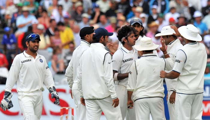 S Sreesanth is congratulated by teammates for getting out Hashim Amla for 59 runs on the first day of the third Test between India and South Africa at the Newlands Stadium in Cape Town. (AFP Photo)