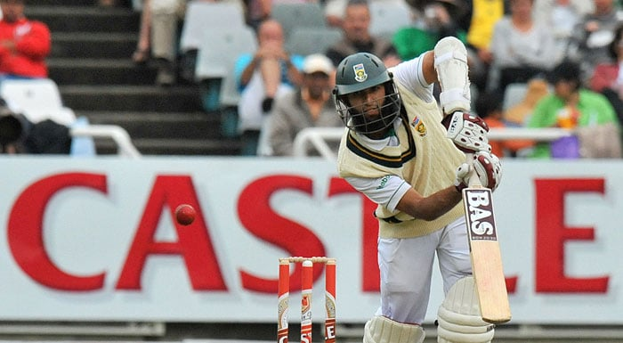 Hashim Amla plays a shot off the bowling of S Sreesanth on the first day of the third Test at the Newlands Stadium in Cape Town. (AFP Photo)