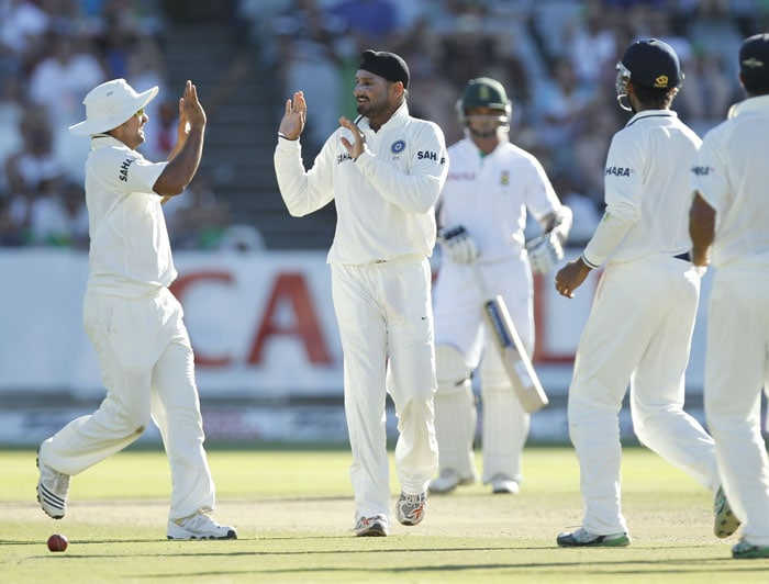 India's Harbhajan Singh, react after taking the wicket of Graeme Smith, during the third day of the third and final Test against India at Newlands Stadium in Cape Town. (AP Photo)