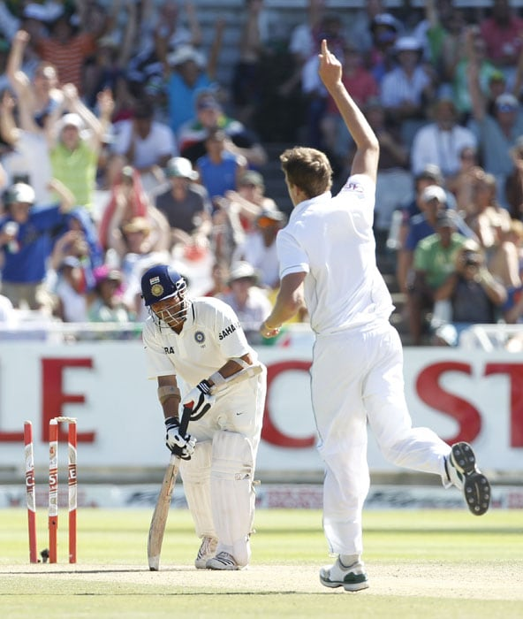 India's Sachin Tendulkar, looks down as South Africa's Morne Morkel, reacts after bowling him out during the third day of the third and final Test against India at Newlands Stadium in Cape Town. (AP Photo)