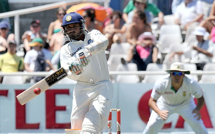Indian batsman Harbhajan Singh plays a shot off a ball by South Africa's Lonwabo Tsotsobe during the third day of the third and final Test against India at Newlands Stadium in Cape Town. (AFP Photo)