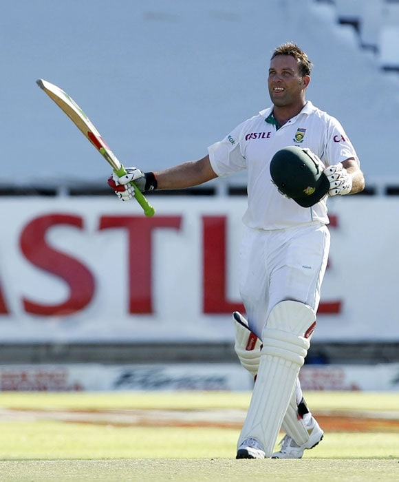 South Africa's Jacques Kallis holds up his bat as he reaches over a hundred runs during the third Test against India in Cape Town. (AP Photo)