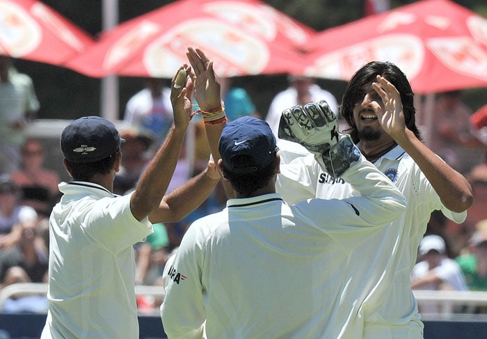 Ishant Sharma is congratulated by teammates for getting out Ashwell Prince during the fourth day of the third Test between India and South Africa at the Newlands Stadium in Cape Town. (AFP Photo)
