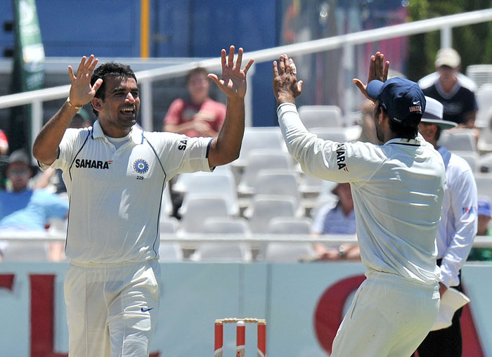 Zaheer Khan celebrates dismissing of AB de Villiers with 13 runs during the fourth day of the third Test between India and South Africa at the Newlands Stadium in Cape Town. (AFP Photo)
