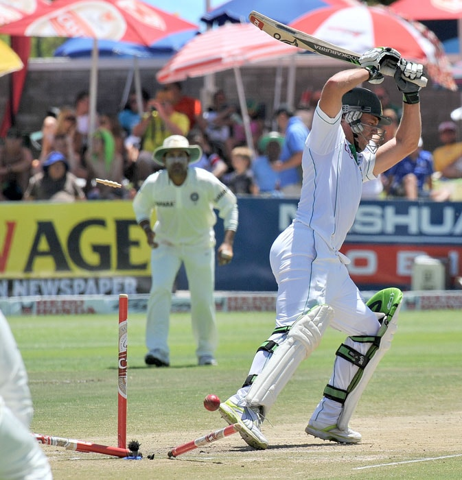 AB de Villiers is clean bowled by Zaheer Khan during the fourth day of the third Test between India and South Africa at the Newlands Stadium in Cape Town. (AFP Photo)