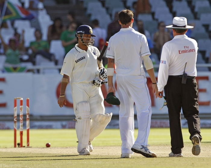 Sachin Tendulkar stand as South Africa and India draw the third Test played in Cape Town. (AP Photo)
