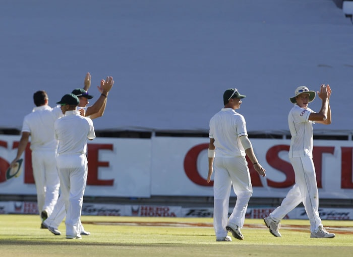 South Africa players clap hands as they draw with India at the end of the third Test in Cape Town. (AP Photo)