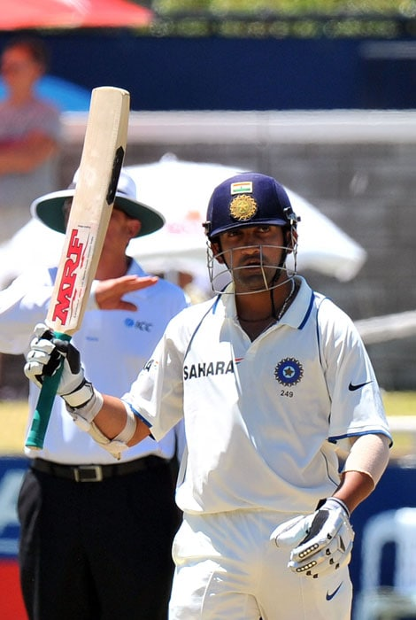 Gautam Gambhir raises his bat after scoring 50 runs on the fifth day of the third and final Test between India and South Africa at the Newlands Stadium in Cape Town. (AFP Photo)