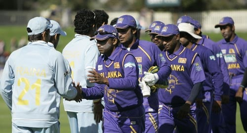 DPMD Jayawardene, front on right side, and his team congratulates India's cricketers after they won the tri-Series One-Day International match in Hobart on Tuesday, February 26, 2008. India won the match by seven wickets.
