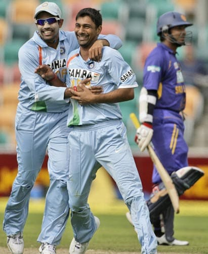 As Sri Lanka's KC Sangakkara right, walks off the field, Praveen Kumar, center, and teammate RV Uthappa celebrate during their tri-Series One-Day International Match in Hobart on Tuesday on February 26, 2008.