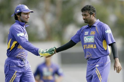M Muralitharan, right, is congratulated by wicket keeper KC Sangakkara after taking the wicket of Tendulkar during their tri-series One-Day International match against India in Hobart on Tuesday, February 26, 2008. India are chasing 180 runs for victory.