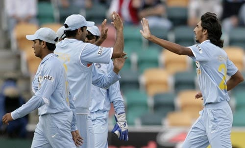 I Sharma, right, celebrates with teammates after taking the wicket of SL Malinga during their tri-series One-Day International match in Hobart on Tuesday, February 26, 2008. Sri Lanka was all out for 179 runs.