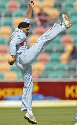 Harbhajan Singh celebrates by kicking the ball after taking the wicket of CK Kapugedera during their tri-series One-Day International match in Hobart on Tuesday, February 26, 2008. Sri Lanka was all out for 179 runs.