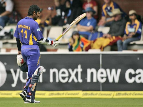 KC Sangakkara walks off the field after his wicket was taken by Praveen Kumar during their tri-Series One-Day International match in Hobart on Tuesday, February 26, 2008.