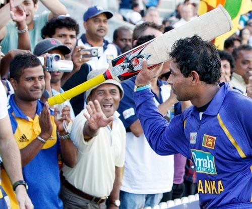 Tillakaratne Dilshan uses his bat to salute the crowd after their One-Day cricket international win over India in Canberra on Tuesday, February 12, 2008.