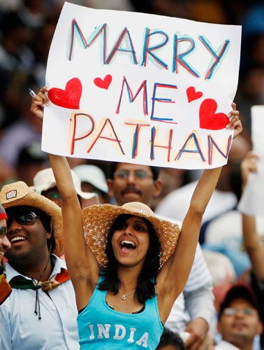 An Indian cricket fan holds up a banner for one of the Indian batsman during their One-Day cricket international against Sri Lanka in Canberra on Tuesday, February 12, 2008.