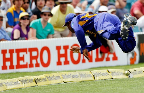Sri Lankan fieldsman Chamara Kupugedera is airborne as he stops the ball during their One-Day cricket international against India in Canberra on Tuesday, February 12, 2008.