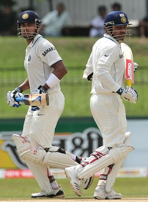 Virender Sehwag (R) and Murali Vijay (L) run between the wickets during the third day of the second Test match between Sri Lanka and India at The Sinhalese Sports Club Ground in Colombo. (AFP Photo)