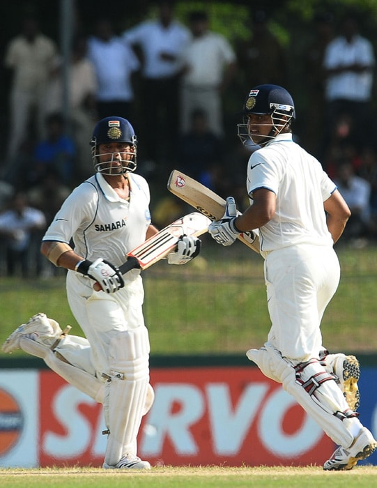 Sachin Tendulkar (L) and Suresh Raina run between wickets during the third day of the second Test match between Sri Lanka and India at The Sinhalese Sports Club Ground. (AFP Photo)