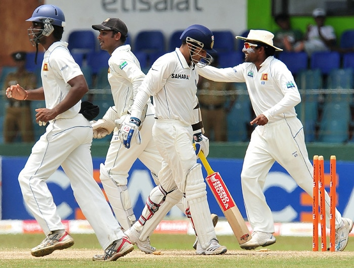 Sri Lankan cricketers celebrate after the dismissal of Indian batsman Virender Sehwag (C) during the third day of the second Test match between Sri Lanka and India at The Sinhalese Sports Club Ground. (AFP Photo)