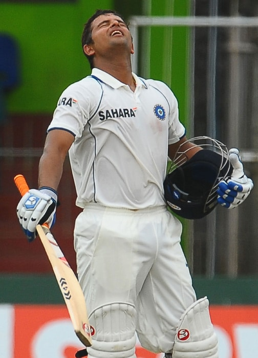 Indian cricketer Suresh Raina reacts upon scoring a century (100 runs) during the fourth day of the second Test match between Sri Lanka and India at The Sinhalese Sports Club Ground in Colombo on July 29, 2010. (AFP Photo).