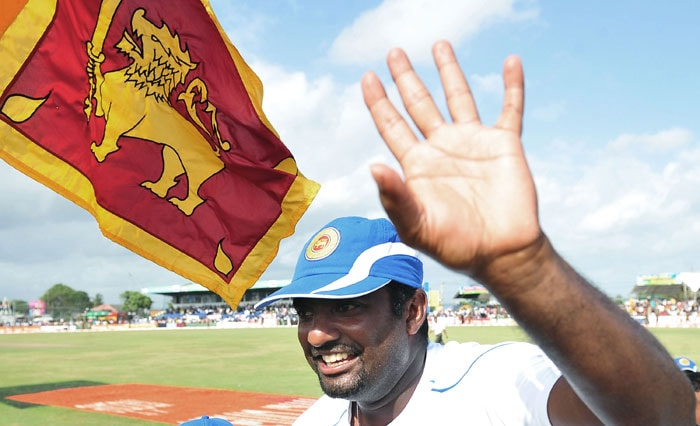 Sri Lankan cricketer Muttiah Muralitharan waves to the crowd as his teammates carry him around the pitch in a lap of honour after they won the first Test match between Sri Lanka and India at The Galle International Cricket Stadium in Galle on July 22, 2010. World bowling record-holder Muttiah Muralitharan retired with 800 Test wickets on Thursday as Sri Lanka thumped India by 10 wickets in their first match. (AFP Photo)