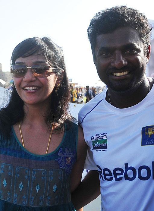 Sri Lankan cricketer Muttiah Muralitharan poses for a photo with his wife Madhimalar after his team won the first Test match between Sri Lanka and India at The Galle International Cricket Stadium. World bowling record-holder Muttiah Muralitharan retired with 800 Test wickets as Sri Lanka thumped India by 10 wickets in their first match. (AFP Photo)