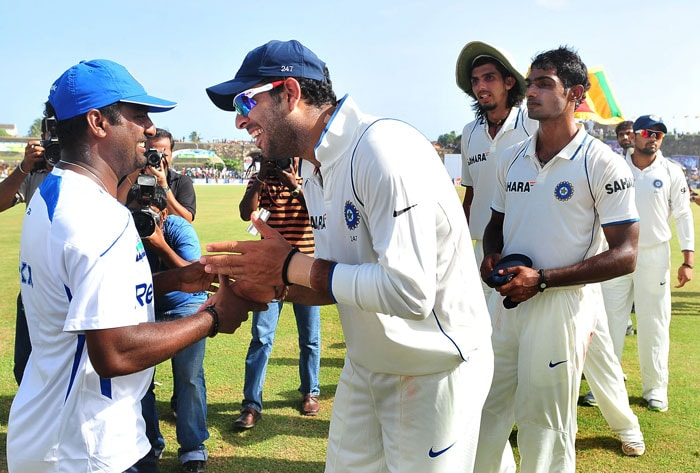 Indian cricketer Yuvraj Singh (2L) and teammates congratulate Sri Lankan cricketer Muttiah Muralitharan (L) after the Sri Lankan victory in the first Test match at The Galle International Cricket Stadium. (AFP Photo)
