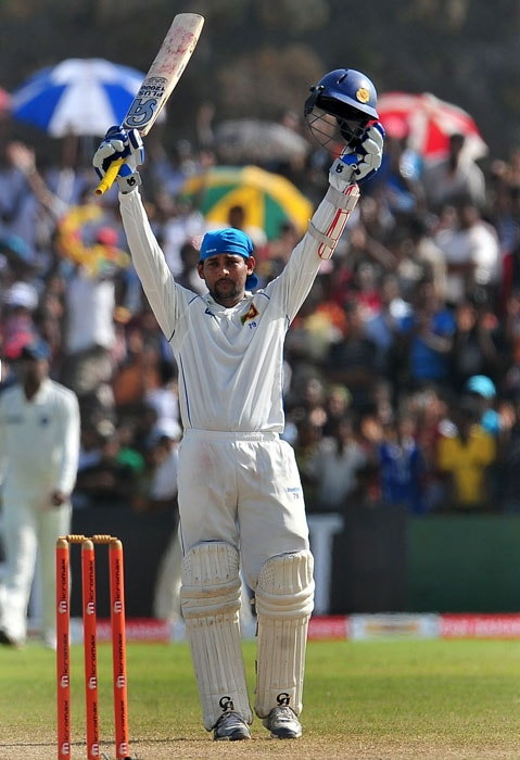 Sri Lankan cricketer Tillekeratne Dilshan celebrates victory on the fifth and final day of the first cricket Test match between Sri Lanka and India at The Galle International Cricket Stadium. (AFP Photo)