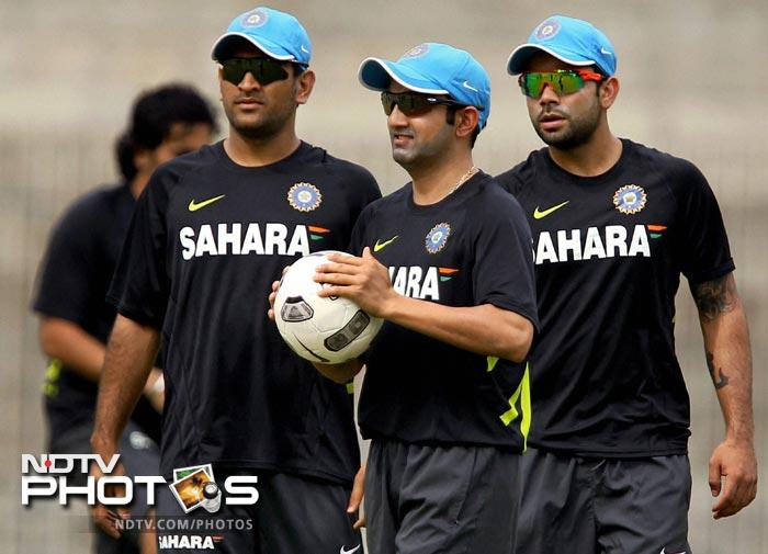 MS Dhoni with Gautam Gambhir and Virat Kohli at a practice session in Chennai. (PTI Photo)