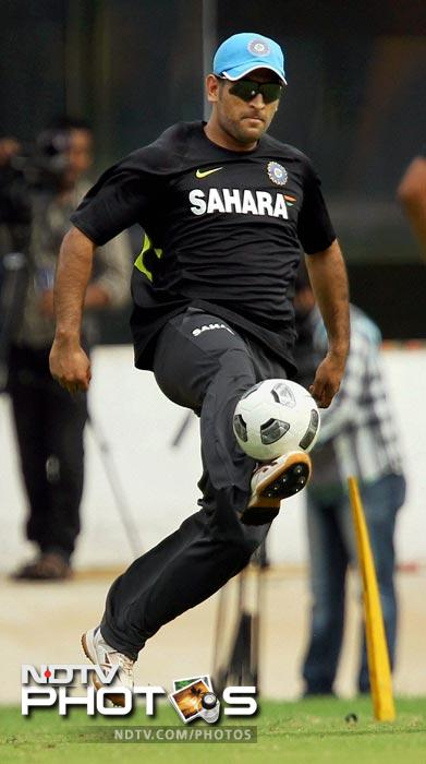 MS Dhoni plays football at the practice session in Chennai. (PTI Photo)