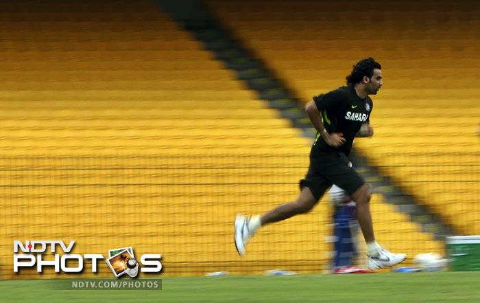 Indian pacer Zaheer Khan runs during a practice session ahead of their Sri Lanka tour in Chennai. (AP Photo)