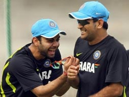 Virat, Dhoni share light moment in Chennai