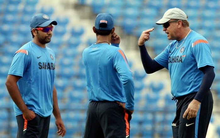 The new fielding coach Michael Young interacts with Rohit Sharma and Dinesh Karthik during a practice session at the Vidharba Cricket Ground at Jamtha in Nagpur. (PTI Photo)