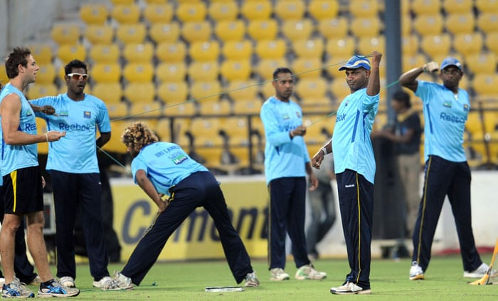 Sri Lankan cricketers warm up during a practice session in Nagpur. (AFP Photo)