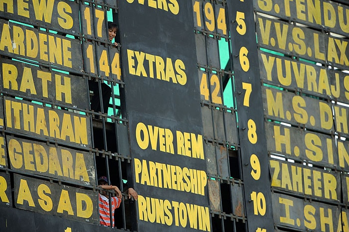 Scorers are seen through a gap in the scoreboard on the fourth day of the first Test between India and Sri Lanka at the Motera stadium in Ahmedabad on Thursday. (AFP Photo)